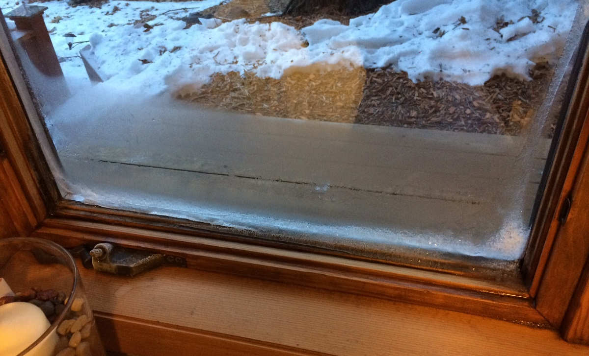 Window condensation that has started to impact wood window frame. Photo by AMEK Exteriors
